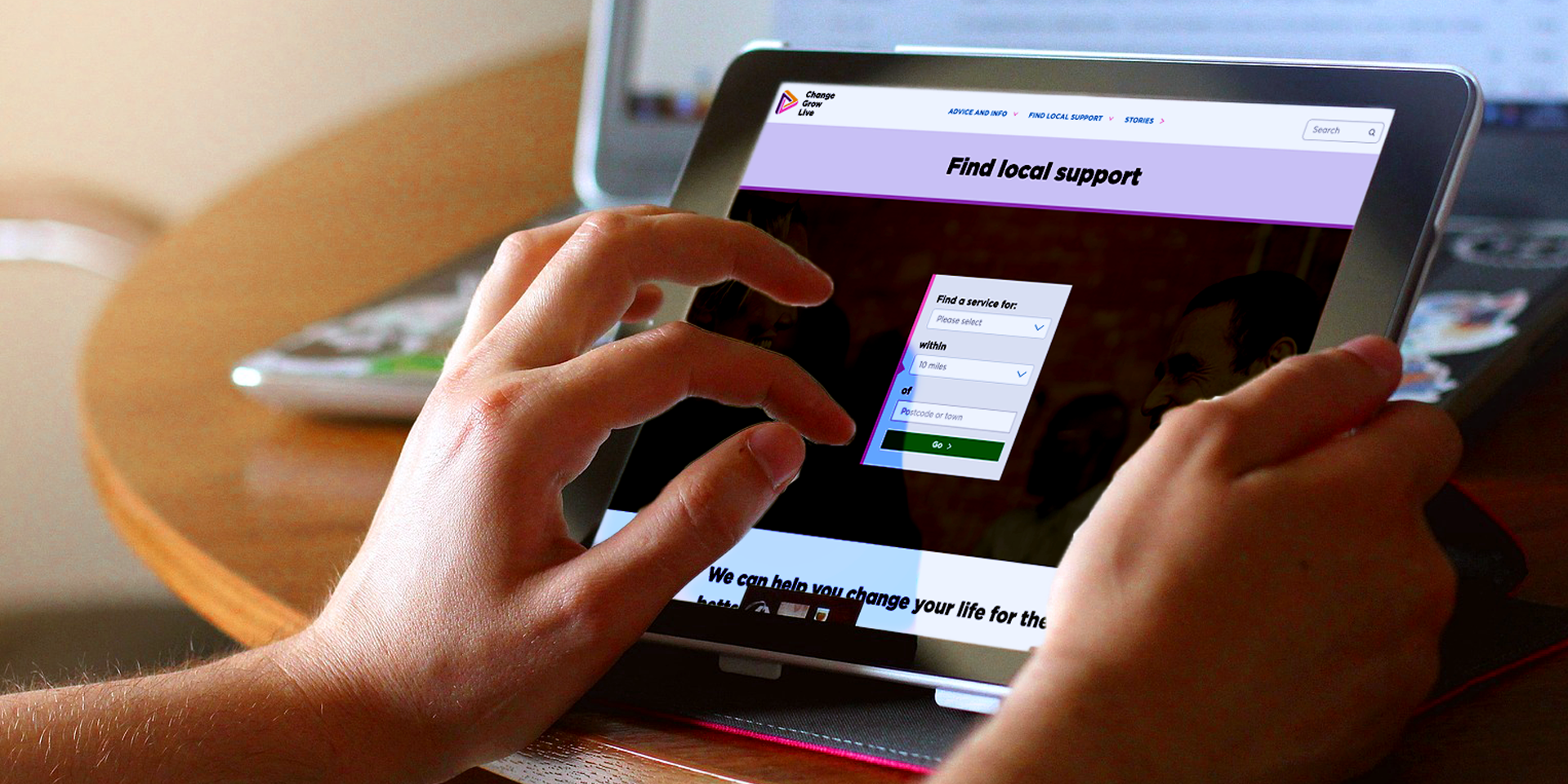 person using this website on a tablet - title of the page is 'Find local support''