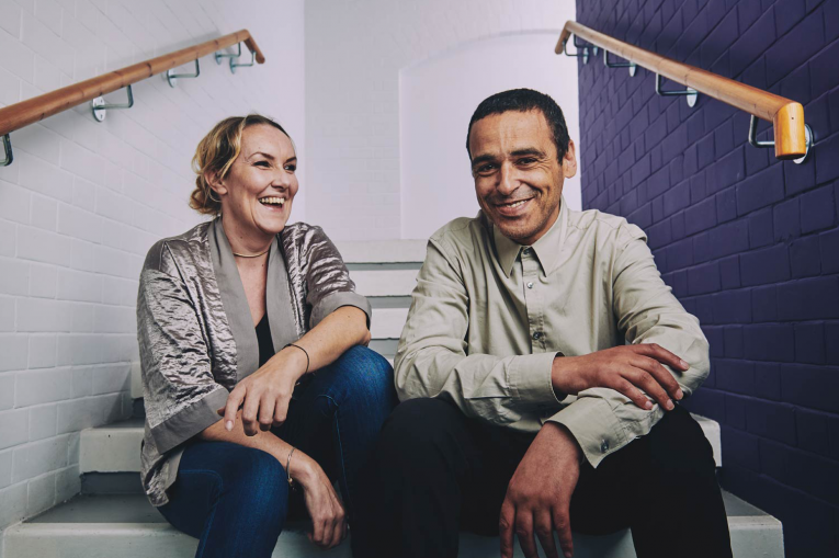 two people sitting on the stairs smiling