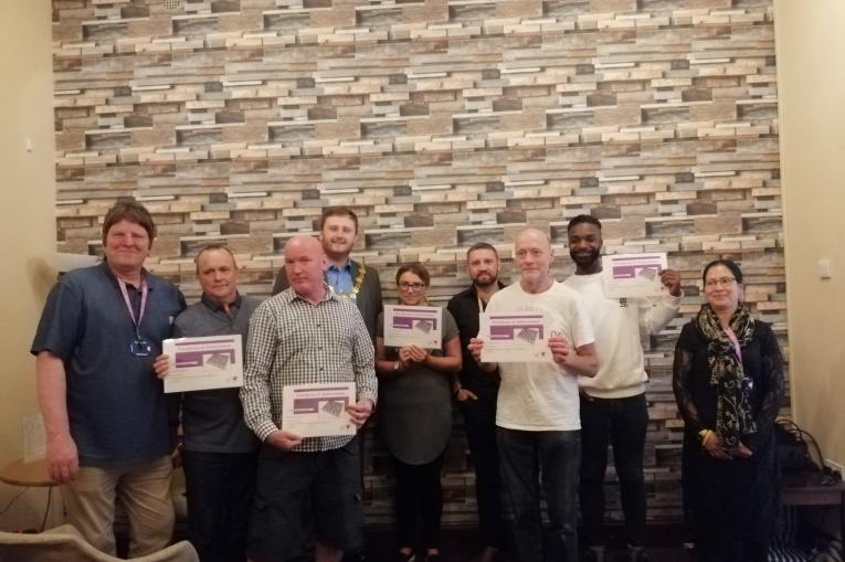 Team members from My Recovery Tameside holding certificates