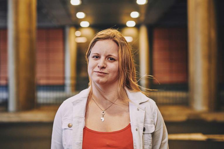 woman smiling under a bridge