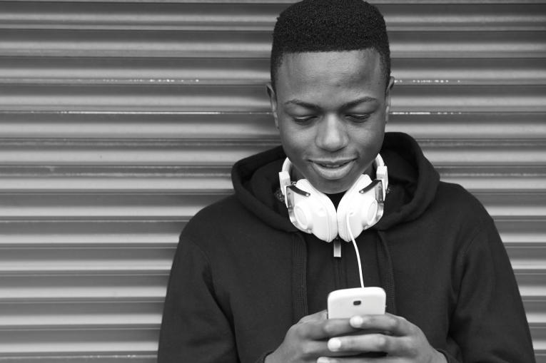 teenage boy using his phone