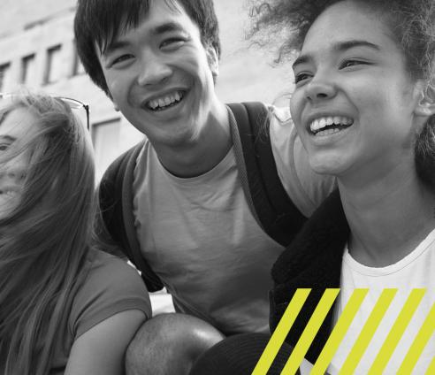 three teenagers smiling and laughing