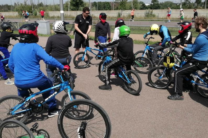 Young people on bikes