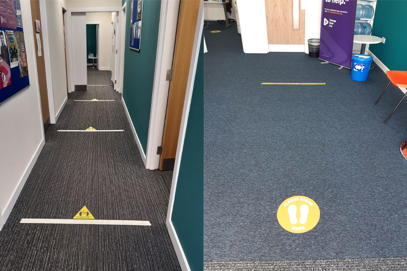 Markers on the floor showing how far apart people need to be