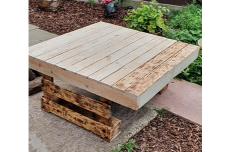 A wooden bench outside