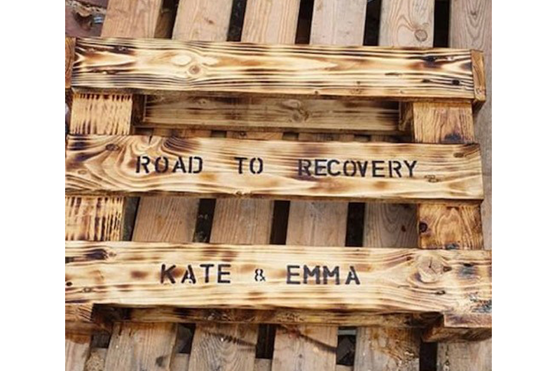 """A bench with """"Road to recovery"""" written on it"""