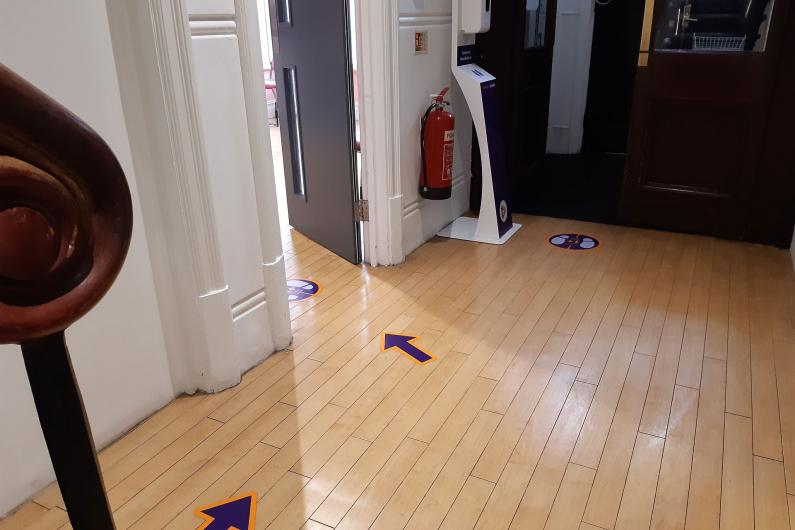 The floor of the service with social distancing markers