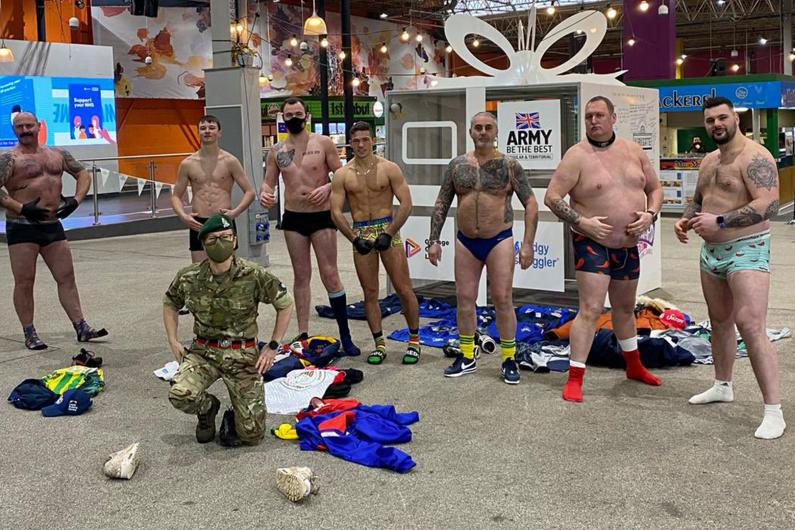 The rugby team stood with their kit off